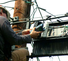IM&R technician working on aerial cables
